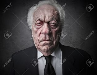 19501715-old-man-with-a-serious-expression-Stock-Photo-business